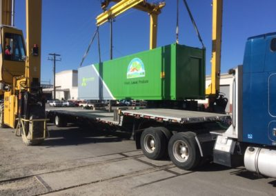 Containerized growing system unit (hydroponic farm) getting loaded for shipping