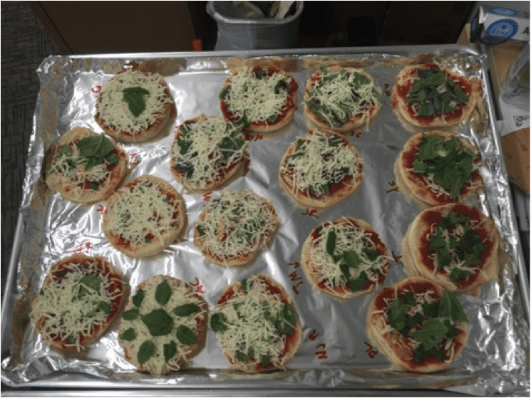 Students at Airports Heights Elementary cook pizza with their hydroponic basil